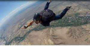 Tommy Fergerson skydiving after losing his arm due to an accident.